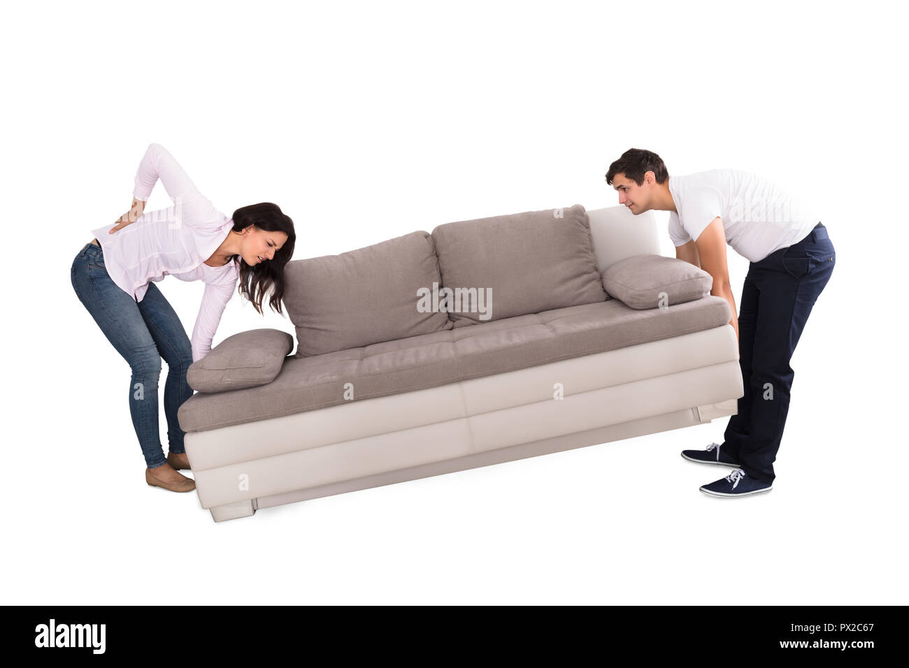 Enjoyable Young Woman Suffering From Back Pain While Lifting Sofa With Ocoug Best Dining Table And Chair Ideas Images Ocougorg
