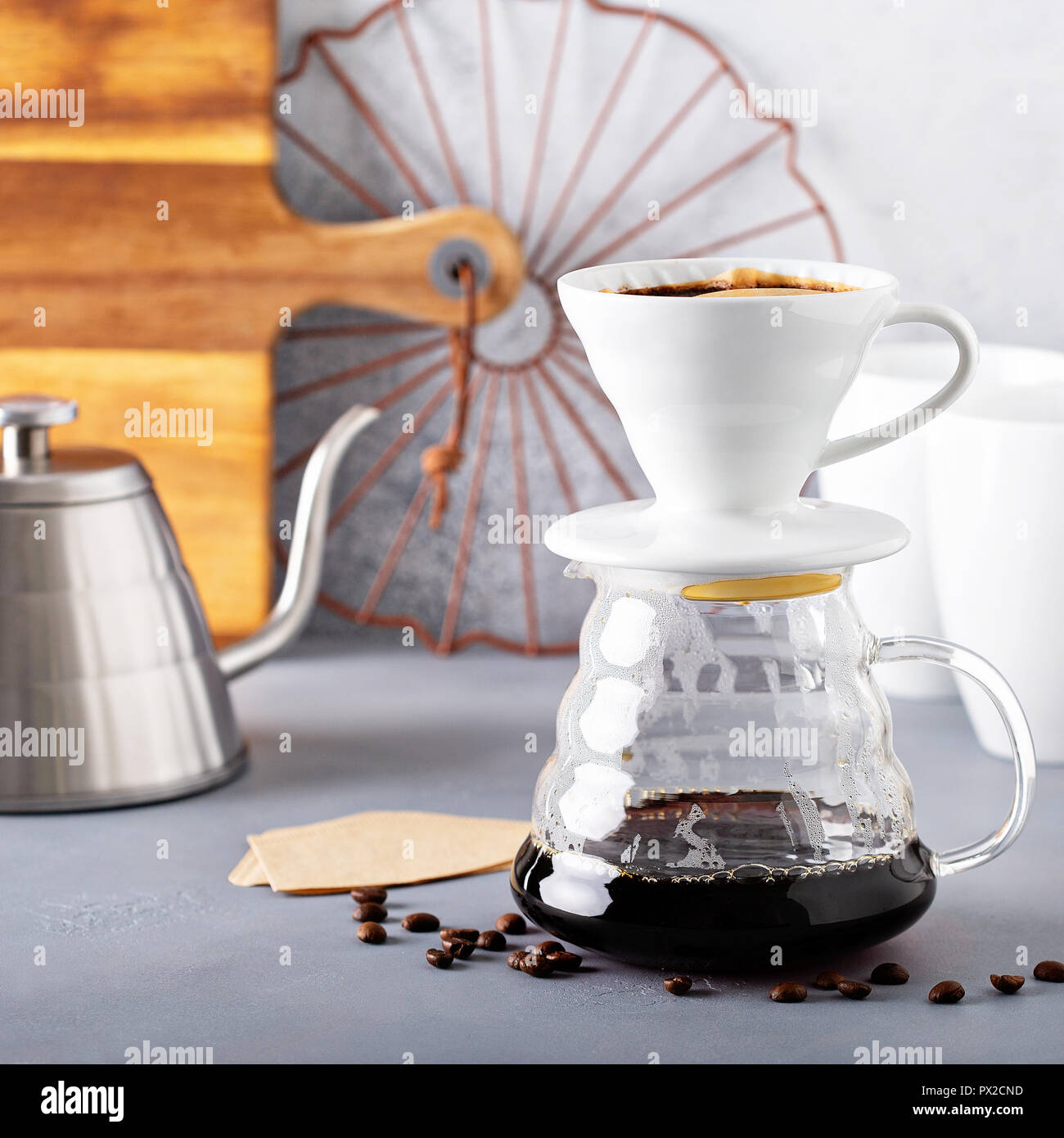 Pour over coffee being made with a kettle and glass carafe - Stock Image