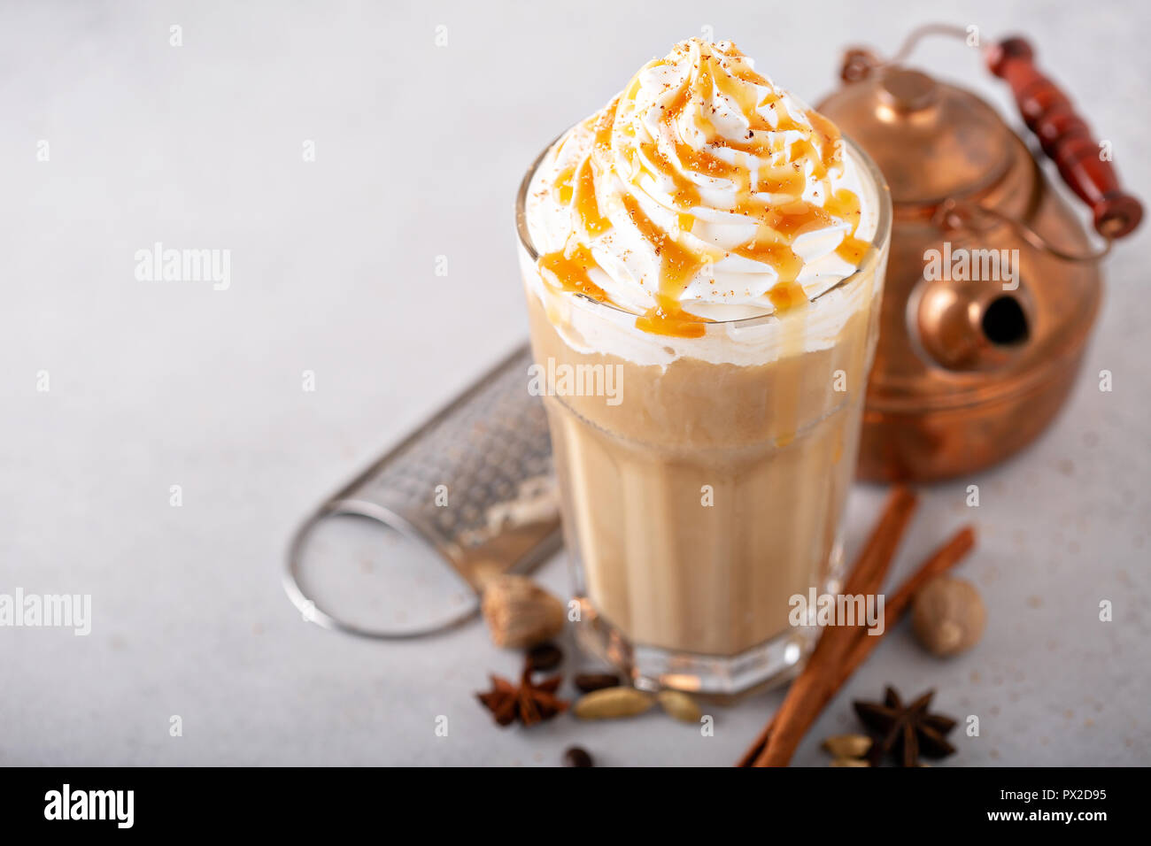 Spiced iced chai latte with whipped cream, seasonal fall drink Stock Photo