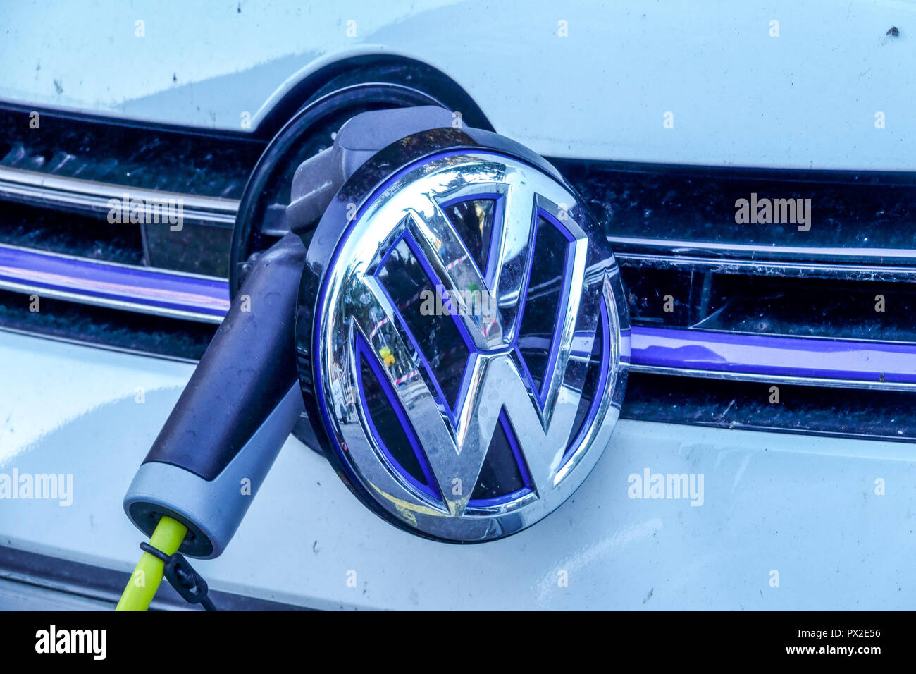 VW car charging, electric car charger, supply plugged - Stock Image