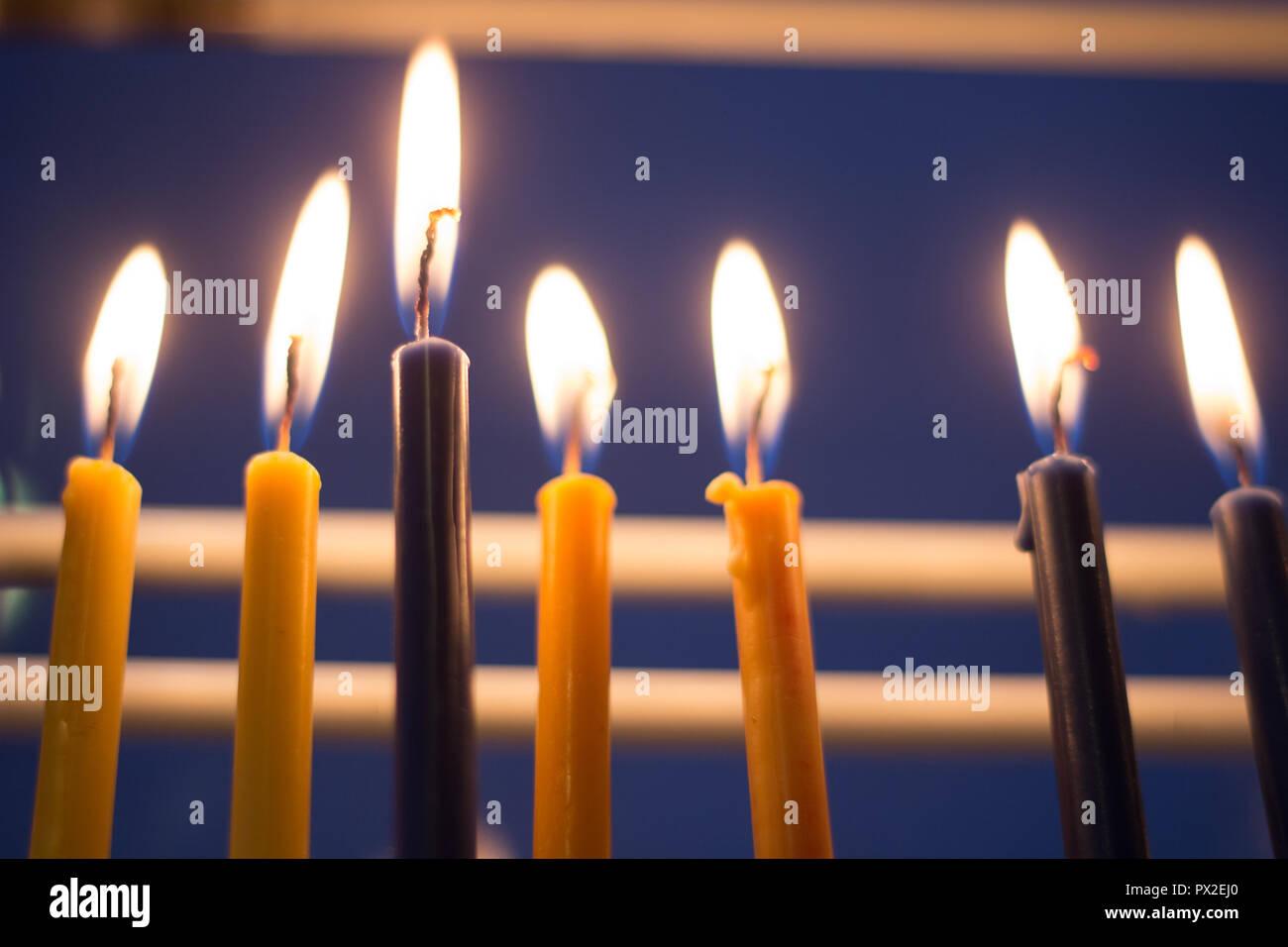 Candle Menora lit in window on Hanuka Holiday - Stock Image