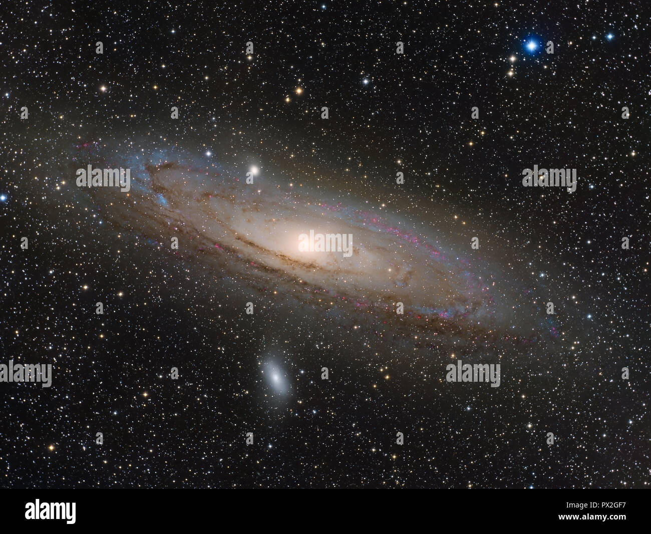 M31 Andromeda galaxy. This shoot in the visible light spectrum and in that of hydrogen, shows the many emission nebulae present in our neighbouring gal - Stock Image