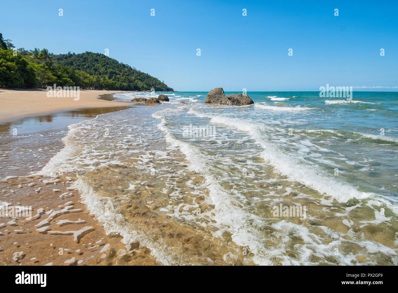 View of gentle waves on the picturesque Etty Bay, Cassowary Coast, Far North Queensland, FNQ, QLD, Australia - Stock Image