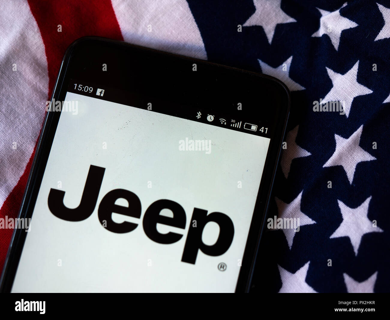 Jeep  logo seen displayed on smart phone/ Jeep is a brand of American automobiles that is a division of FCA US LLC, a wholly owned subsidiary of the Italian-American corporation Fiat Chrysler Automobiles. Stock Photo