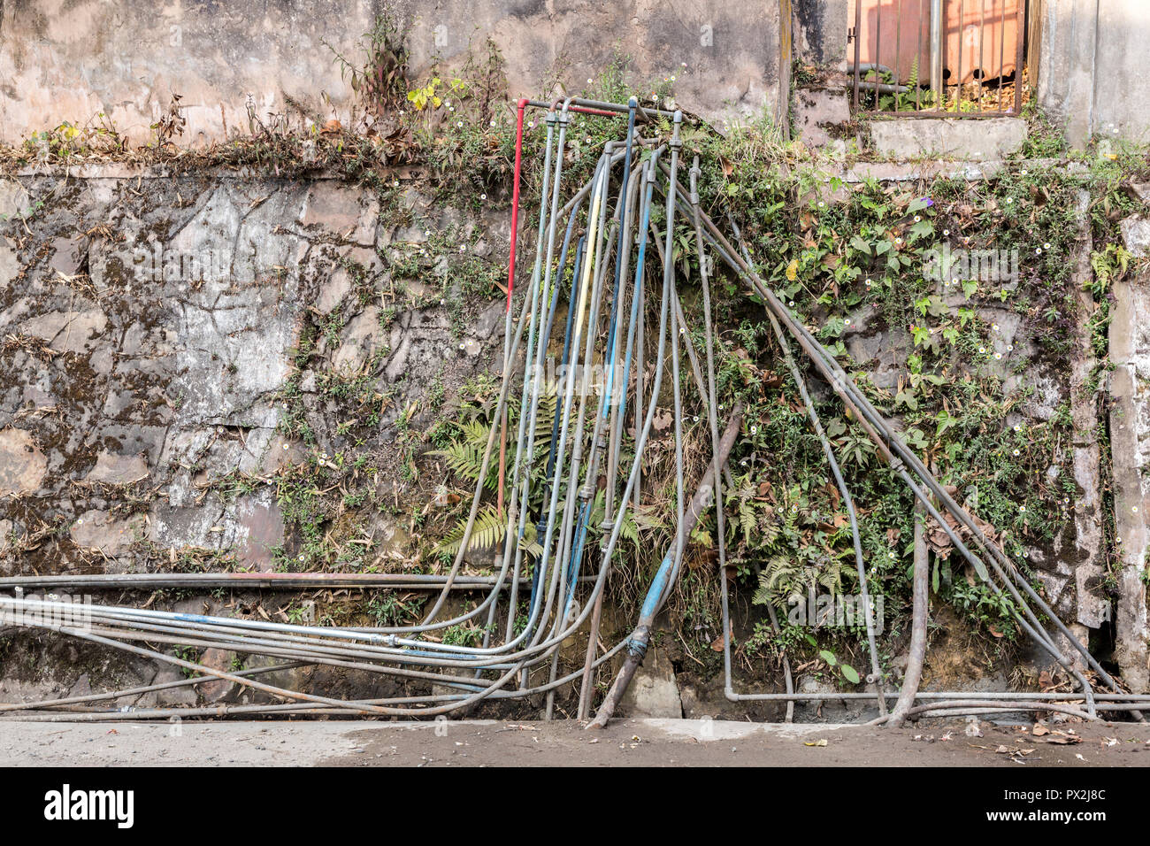 Water pipes in street, Shillong, Meghalaya, India - Stock Image
