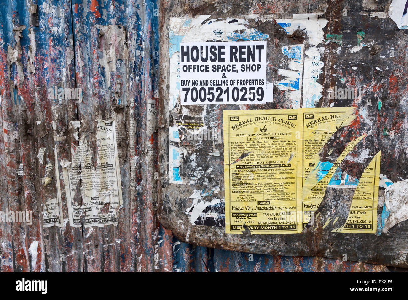 Advertising posters on side of fence, Shillong, Meghalaya, India - Stock Image