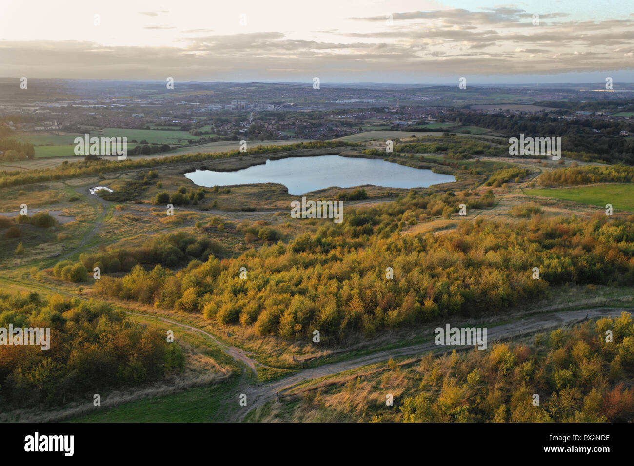 Drone aerial of flanderwell rotherham, south yorkshire UK, and small natural lake formed by water drainage. - Stock Image
