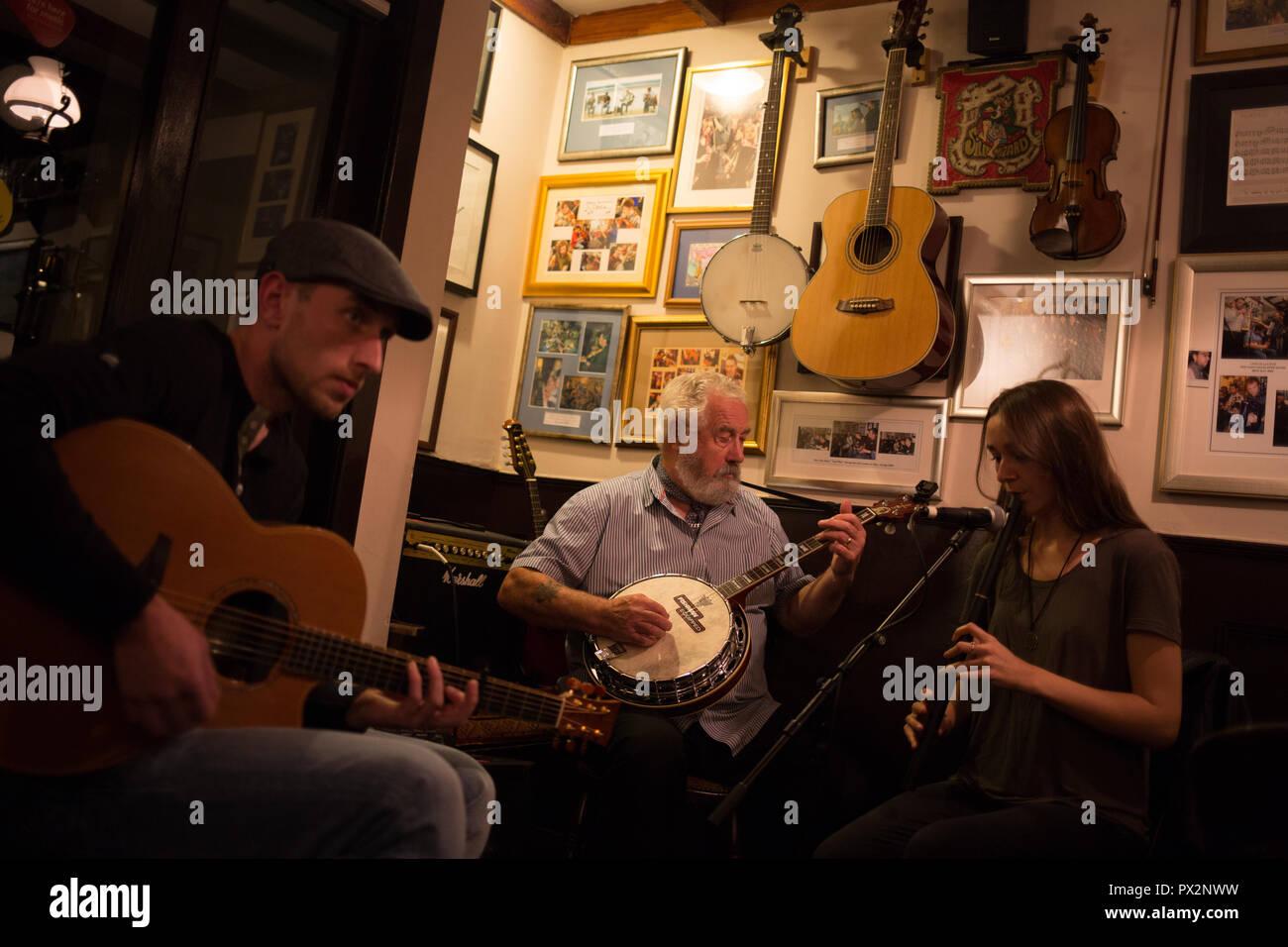 Traditional Scottish folk music band in Port Charlotte Hotel bar, in Port Charlotte, Scotland, on 14 October 2018. - Stock Image