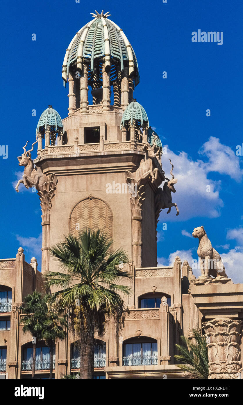 This ornate tower with sculptures of African animals is an architectural feature of The Palace of the Lost City, a luxurious 5-star hotel at the world-renowned Sun City holiday resort in the North West Province of South Africa. That famed playground offers vacationers everything from a water park with a wave pool, golf courses, a gambling casino, hot-air balloon rides, and even animal safaris in the adjacent game park. - Stock Image