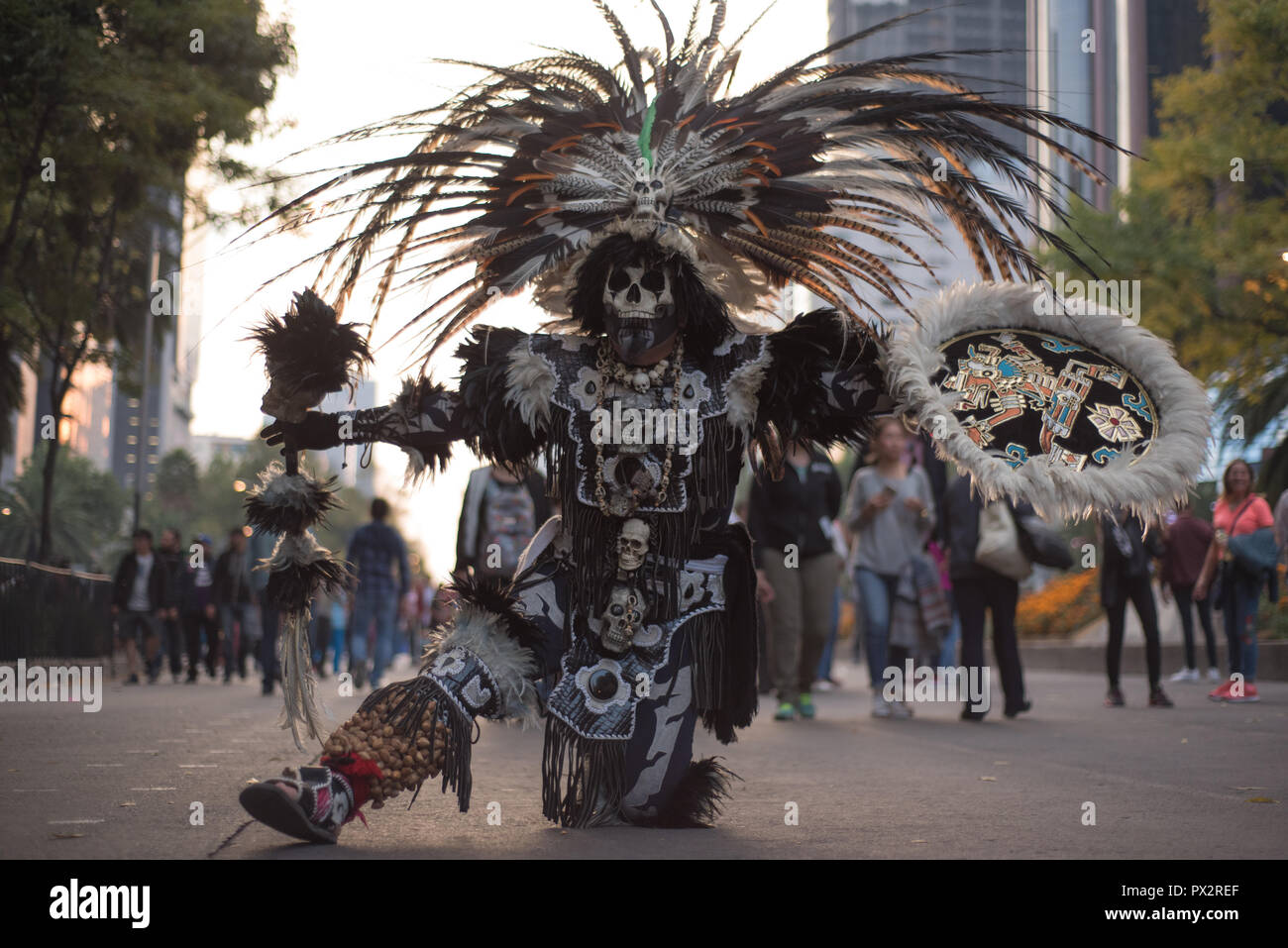 A man dressed like an Aztec warrior wearing typical makeup at the Day of the Dead parade in Mexico City Stock Photo