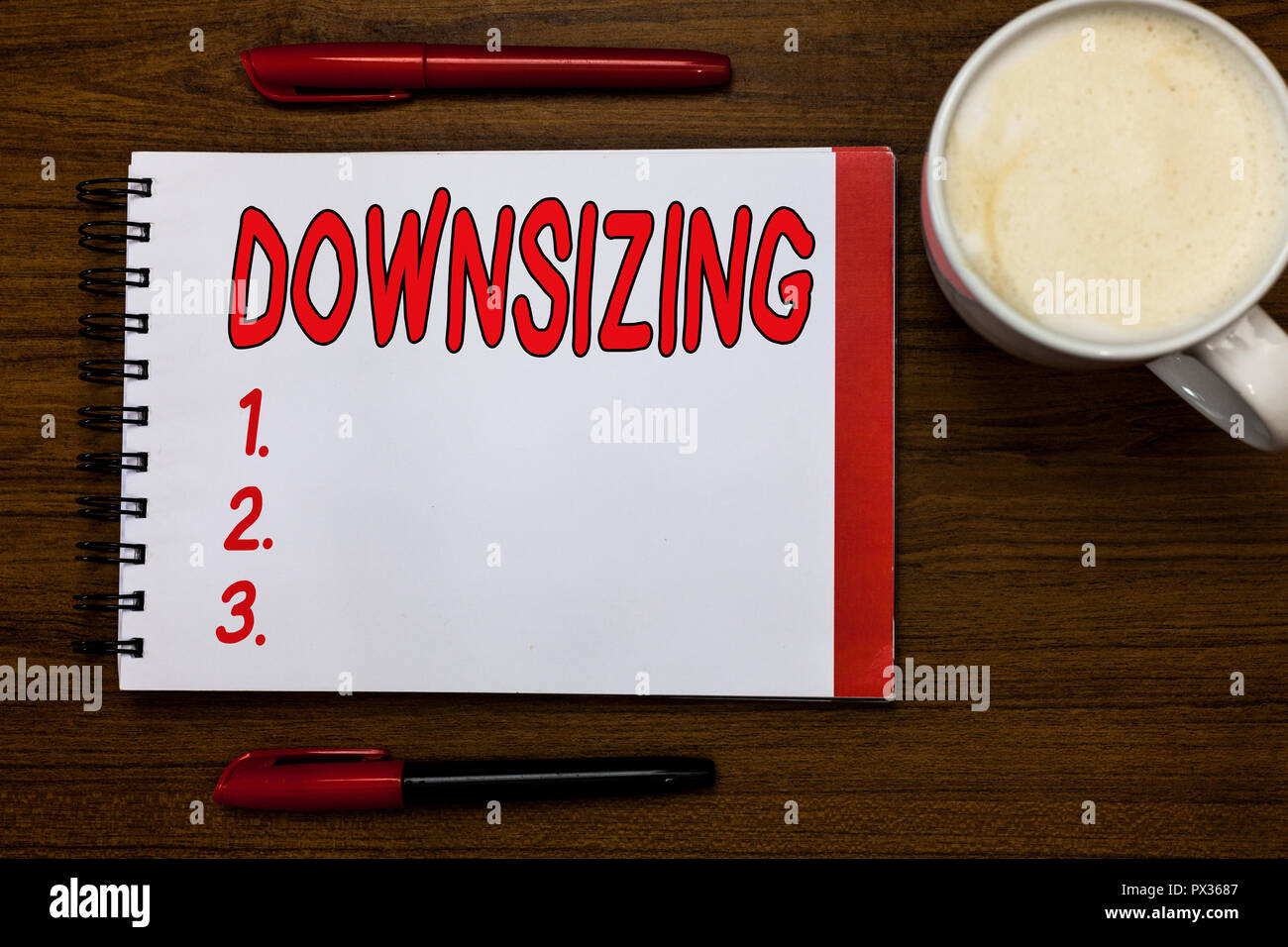 Handwriting text writing Downsizing. Concept meaning Make a company smaller by shedding staff Expenses reduction Open notebook markers inspiration com - Stock Image