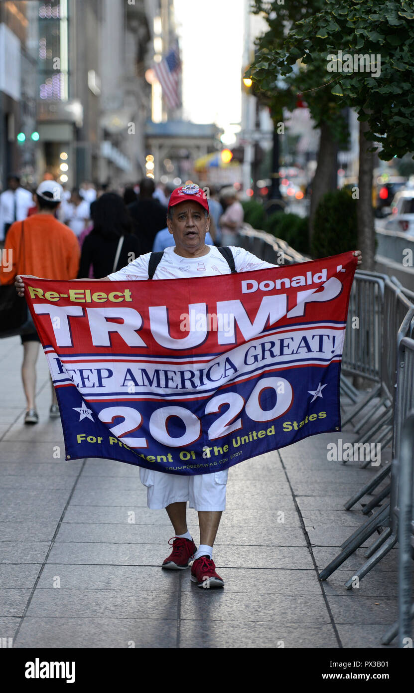 USA, New York City, Donald Trump supporter with banner for re-election of Trump for president  in 2020 in front of Trump tower at 5th Avenue , his slogan: TRUMP keep America great ! / Trump Befuerworter mit Wiederwahl 2020 Plakat vor dem Trump Tower , sein slogan Keep America great! - Stock Image