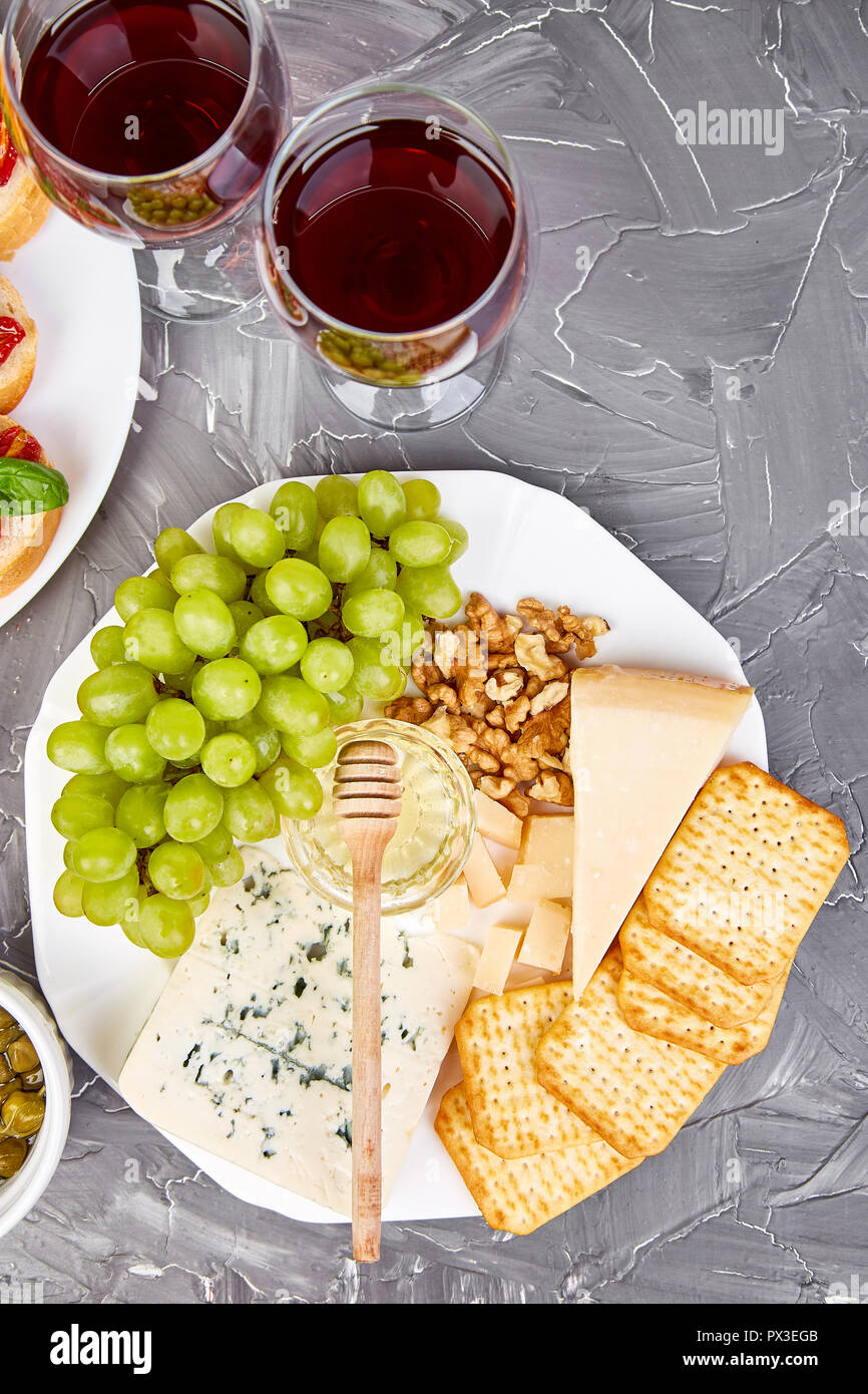 Cheese Plate Variety And Wine In Glasses On Grunge Grey Background Italian Antipasti Wine Snacks Set Flat Lay Copy Space Stock Photo Alamy