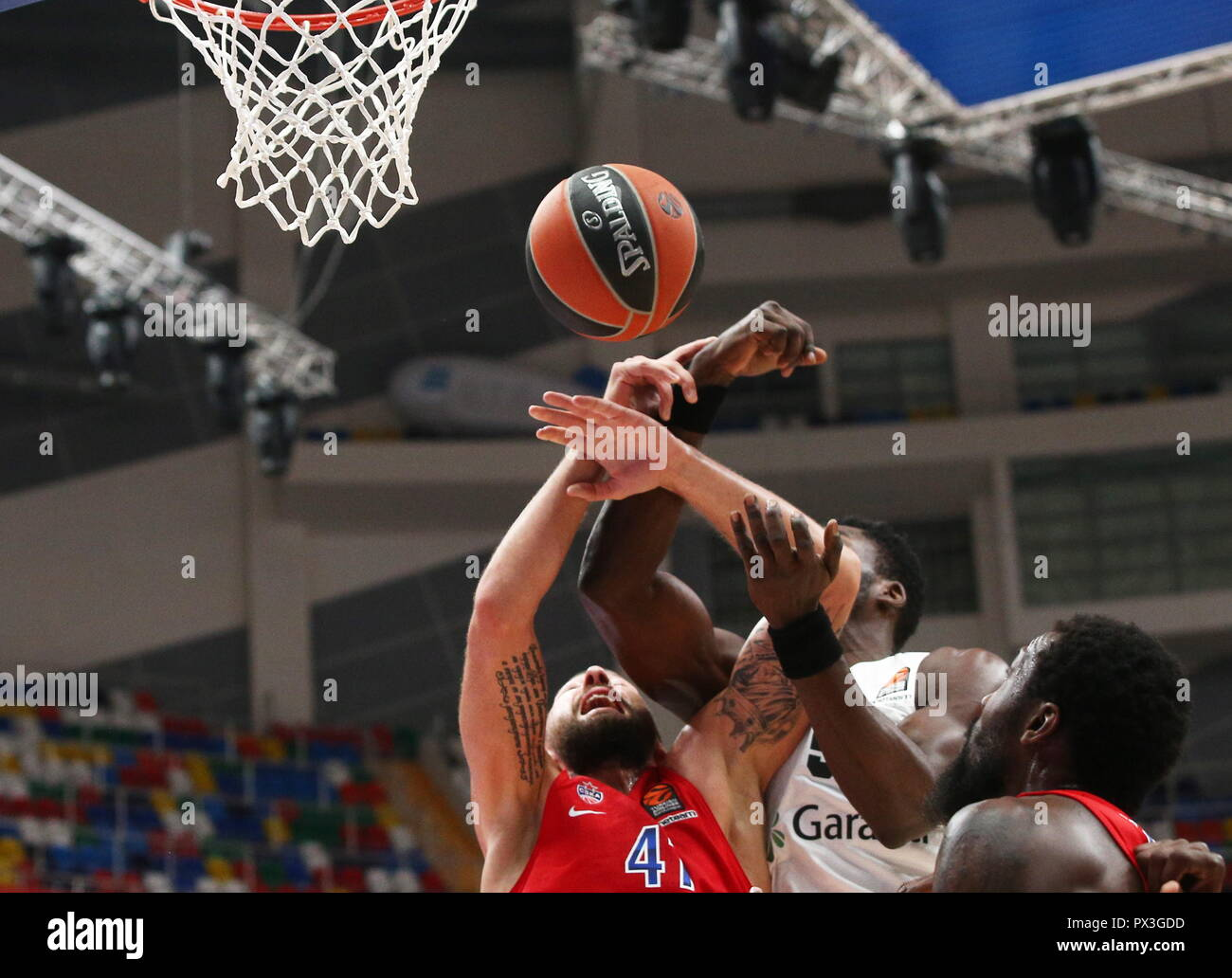 ATTENTION EDITORS! PLEASE, UPDATE THE SCORE IN CAPTIONS FOR TASS IMAGES BY ALEXANDER SCHERBAK, DATED 18 OCTOBER 2018, TITLED '2018/2019 Euroleague: CSKA Moscow 80 - 75 Darussafaka Tekfen Istanbul' OR '2018/2019 Euroleague: CSKA Moscow vs Darussafaka Tekfen Istanbul'; THE SCORE HAS BEEN ALTERED BY EUROLEAGUE OFFICIALS.  CORRECTED TITLE: '2018/2019 Euroleague: CSKA Moscow 79 - 75 Darussafaka Tekfen Istanbul'.  EXAMPLE OF CORRECTED CAPTION: 'MOSCOW, RUSSIA - OCTOBER 18, 2018: CSKA Moscow's Nikita Kurbanov (L) and Darussafaka Tekfen Istanbul's Micheal Eric (2nd R) in a 2018/2019 Euroleague Regular - Stock Image