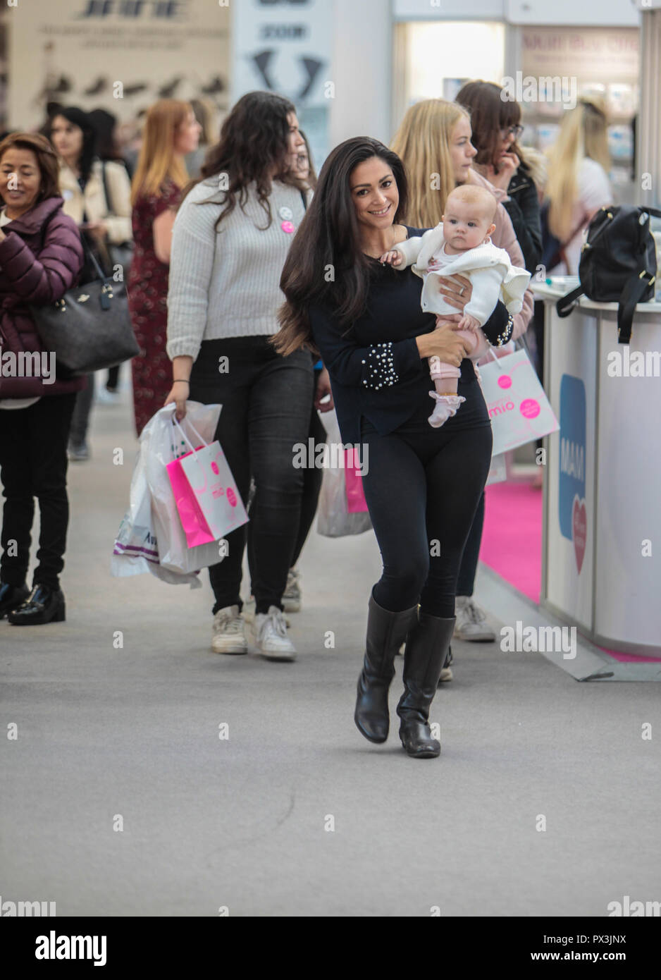 London Uk 19 October 2018 Casey Batchelor and baby model shot to fame when she appeared  Celebrity Big Brother.,with baby Florence visiting The Baby Show in the Olympia center today ,billed as ' The UK's favourite shopping event for new and expectant parents'  with the presence of the biggest name in the high street to the biggest name in celebrities parents ,@Paul Quezada-Neiman/Alamy Live News - Stock Image