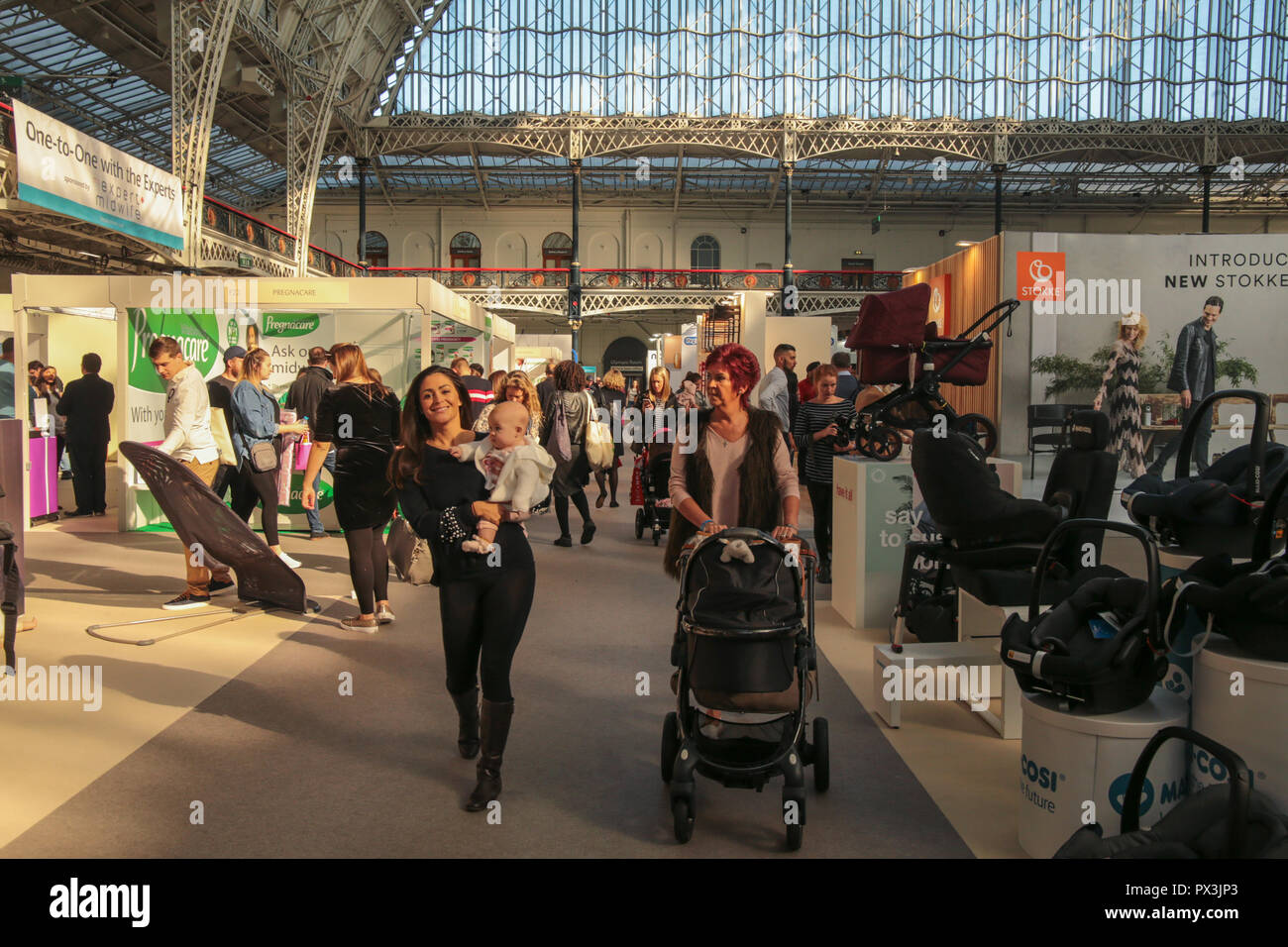 London Uk 19 October 2018 Cassey Batchelor  model shot to fame when she appeared on Celebrity Big Brother. and baby Florence visiting The Baby Show in the Olympia center today ,billed as ' The UK's favourite shopping event for new and expectant parents'  with the presence of the biggest name in the high street to the biggest name in celebrities parents ,@Paul Quezada-Neiman/Alamy Live News - Stock Image