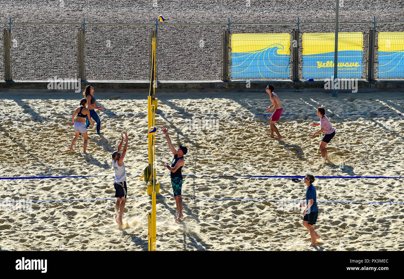 Brighton UK 19th October 2018 - Beach volleyball players enjoy the beautiful warm sunny weather at the Yellowave Centre on Brighton seafront today Credit: Simon Dack/Alamy Live News Stock Photo