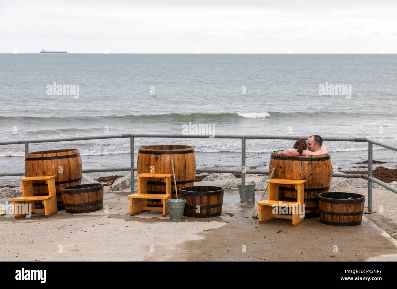 Rocky Bay, Cork, Ireland. 19th October, 2018. Will Condon and Maria O' Sullivan from Nohoval enjoying a hot seaweed bath on a cold October day in Rocky Bay, Co. Cork, Ireland. Credit: David Creedon/Alamy Live News - Stock Image