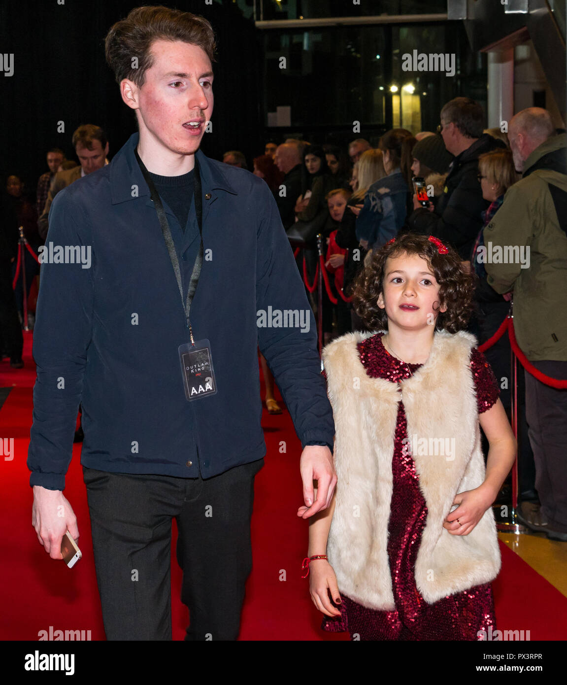 Vue Omni, Leith Walk, Edinburgh, Scotland, United Kingdom, 19th October 2018. Stars attend the Scottish premiere of Netflix Outlaw King. The red carpet is laid out the for the cast and team producing Netflix's latest blockbuster film. Josie O'Brien, who plays Marjorie, Robert the Bruce's daughter is escorted - Stock Image