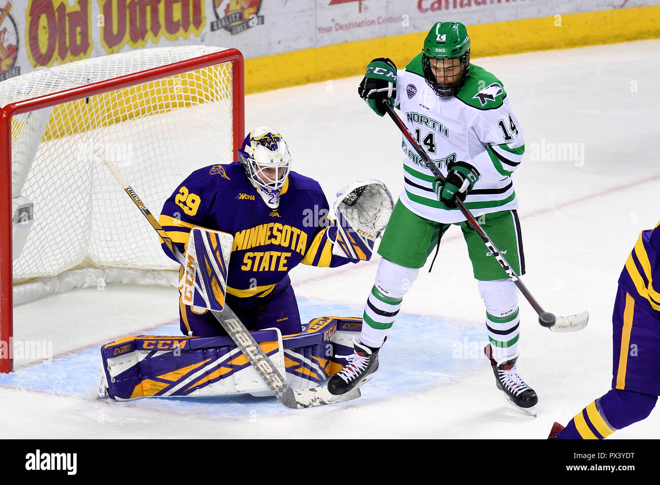 October 19, 2018 North Dakota Fighting Hawks forward Jasper Weatherby (14) redirects a shot in front of Minnesota State Mavericks goaltender Dryden McKay (29) during a NCAA men's college hockey game between the Minnesota State Mavericks and the University of North Dakota Fighting Hawks at Ralph Engelstad Arena in Grand Forks, ND Mankato won 7-4. Photo by Russell Hons/CSM - Stock Image