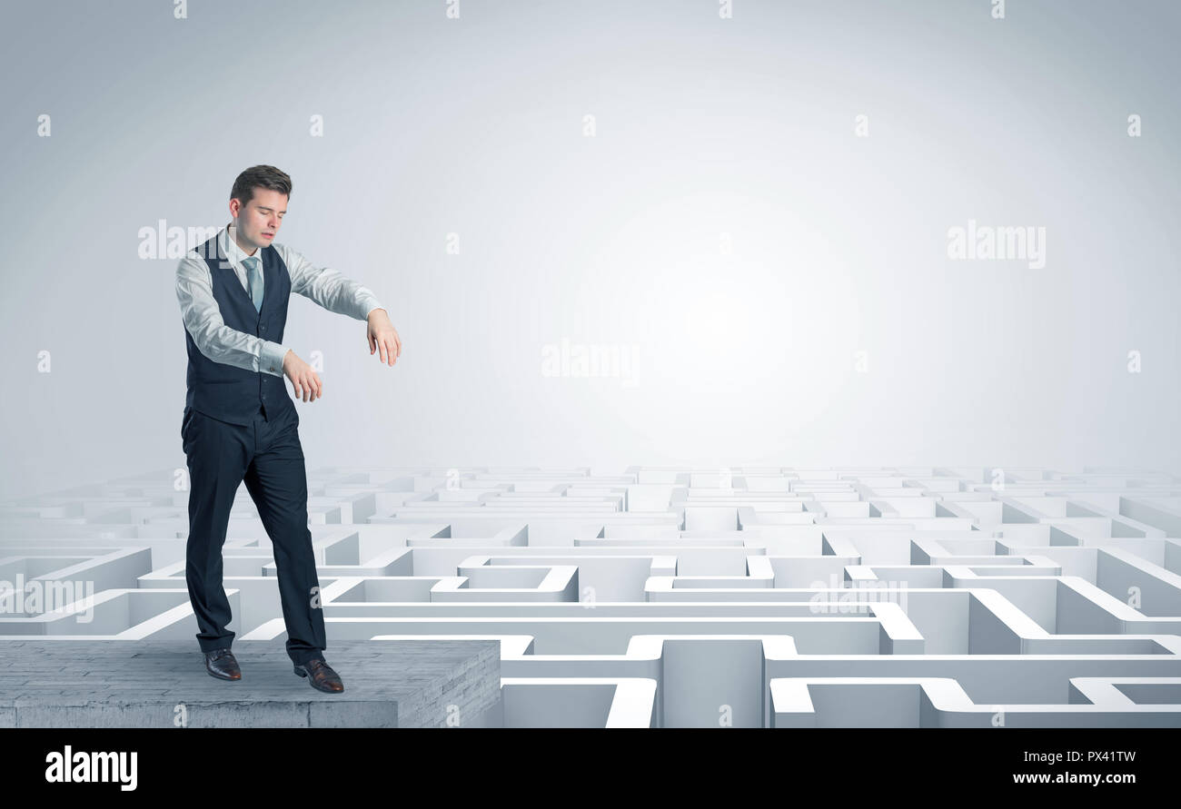 Zombi elegant businessman on the top of a labyrinth  - Stock Image