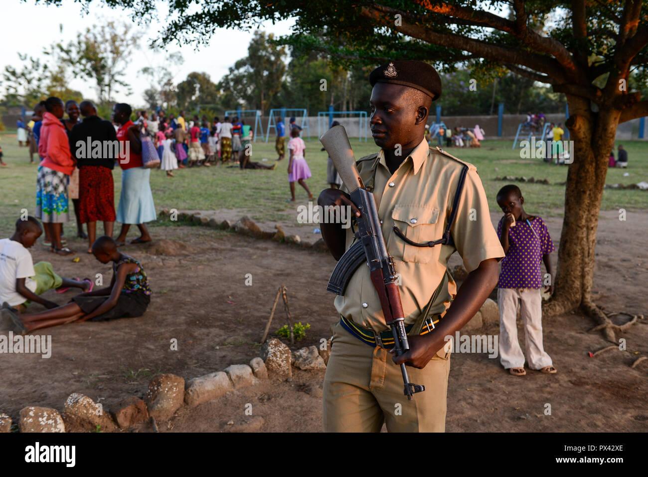 TANZANIA Mara, Tarime, village Masanga, region of the Kuria tribe who practise FGM Female Genital Mutilation, temporary rescue camp of the Diocese Musoma for girls which escaped from their villages to prevent FGM, , armed police secure the camp published in misso magazine 5/2015 - Stock Image