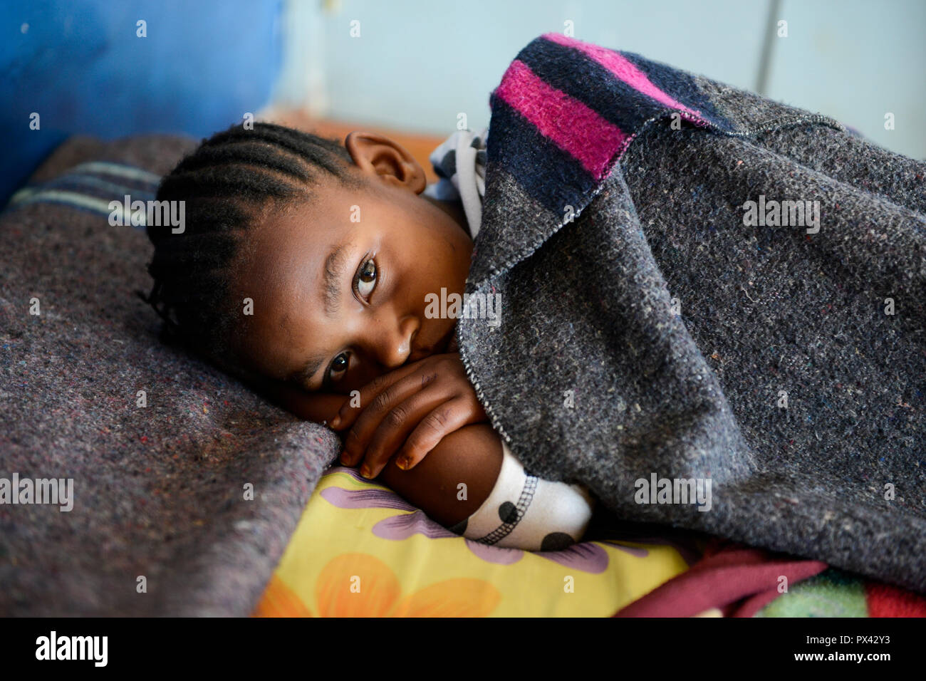 TANZANIA Mara, Tarime, village Masanga, region of the Kuria tribe who practise FGM Female Genital Mutilation, temporary rescue camp of the Diocese Musoma for girls which escaped from their villages to prevent FGM, children stay and sleep in school which is the temporary camp - Stock Image