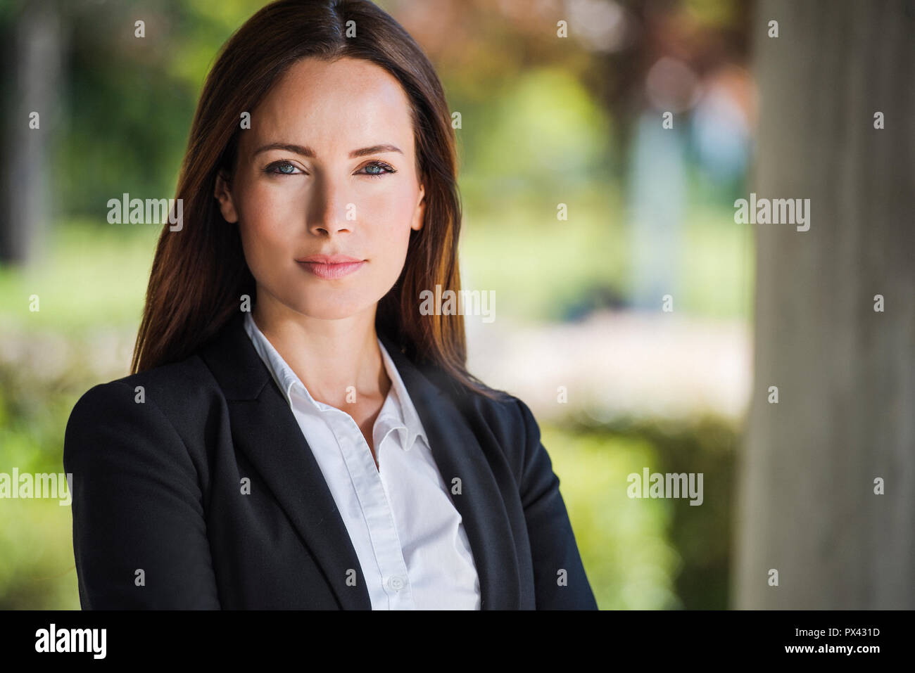 Business woman with crossed arms smiling. With copy space. - Stock Image