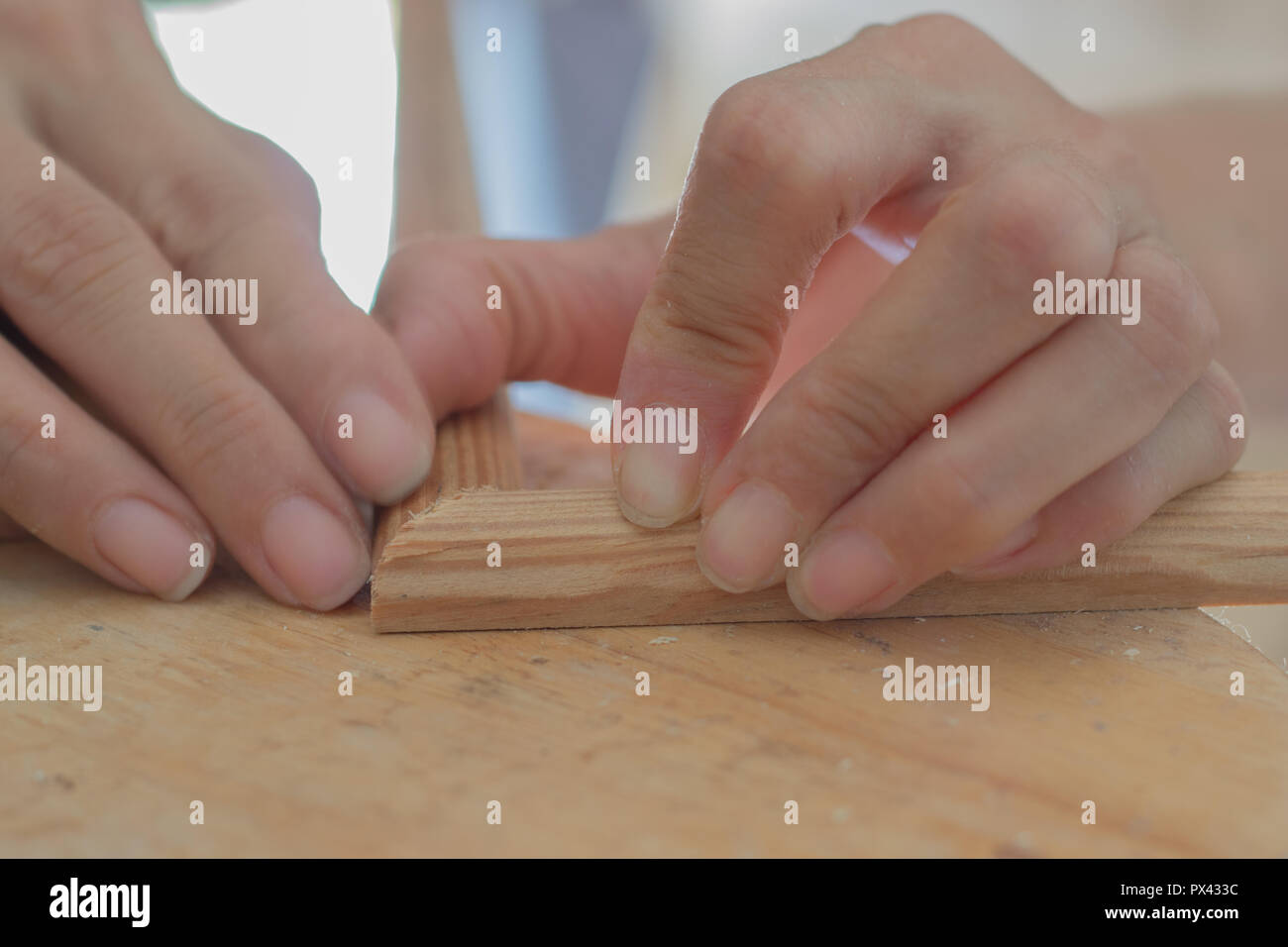 Close Up of Female Wood Worker Working - Stock Image