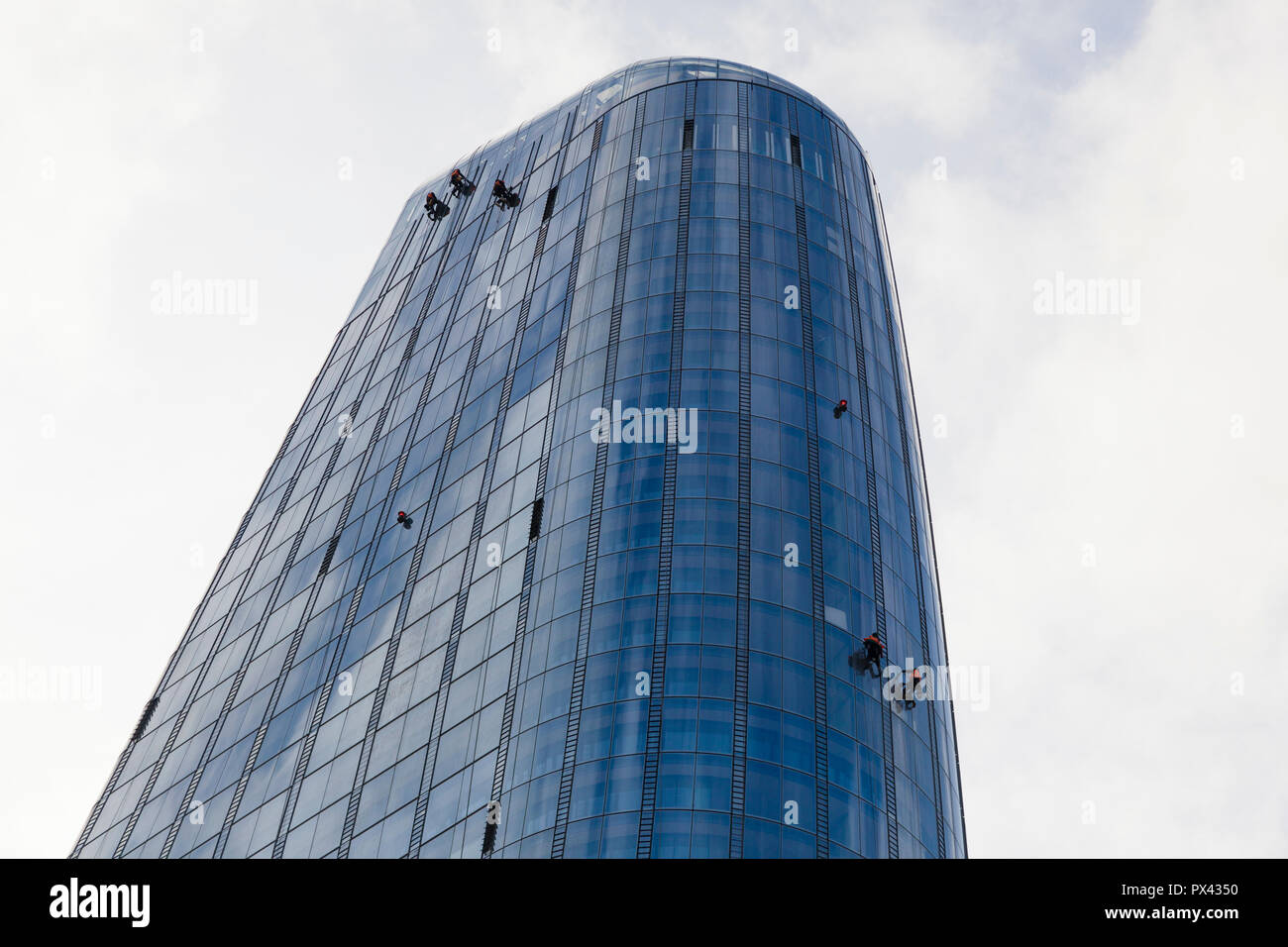 d68c9b280f Maintenance operatives or window cleaners working from ropes on the outside  of a tower block in London