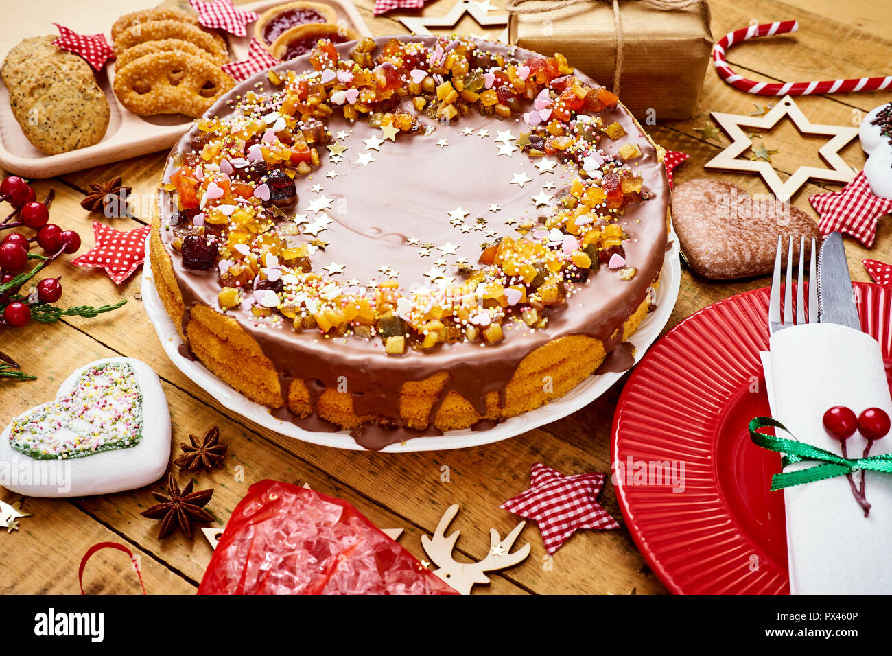 Old Wooden Table With Delicious Christmas Cake Decorations And