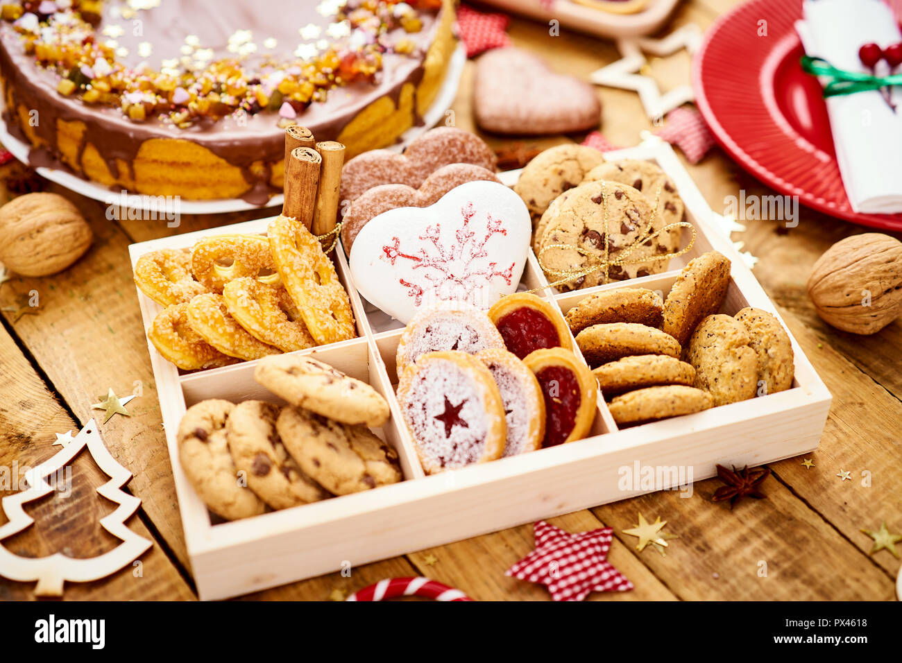 Old Wooden Table With Delicious Christmas Cookies In A Box And
