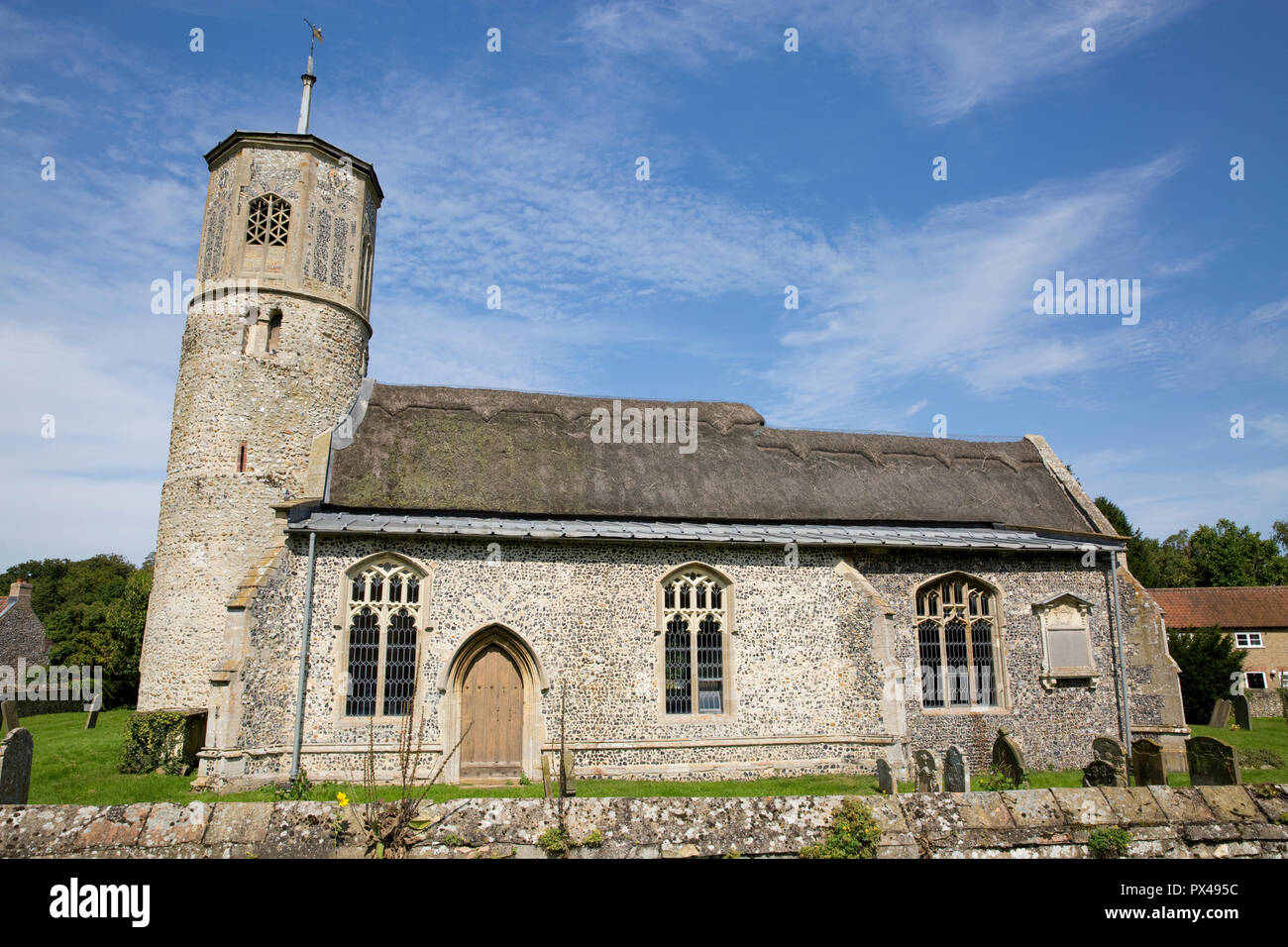 St Mary the Virgin Church, with its octagonal tower and thatched roof nave in the village of Beachamwell, Norfolk, United Kingdom Stock Photo