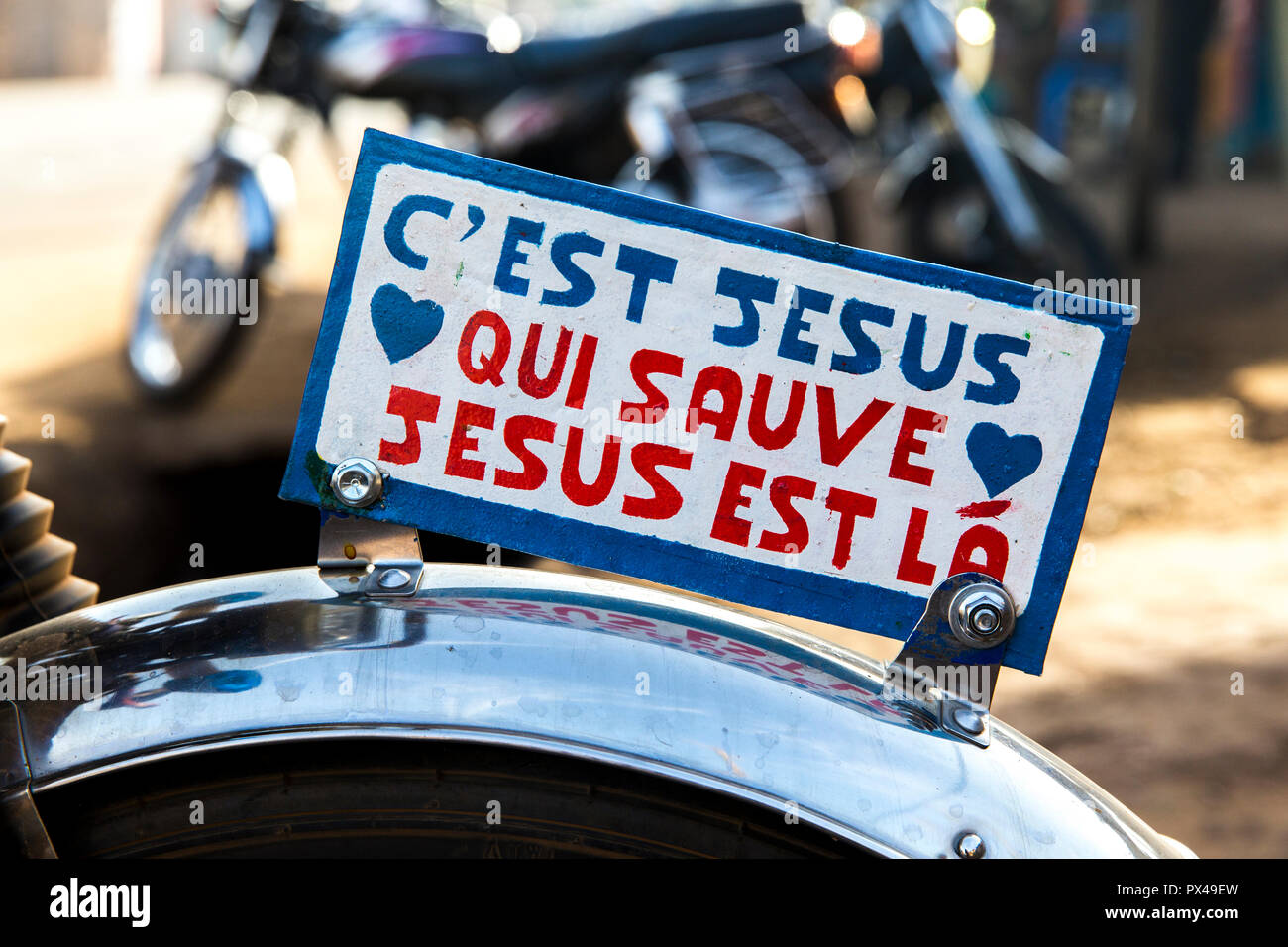 Evangelical message on a motorcycle in Dapaong, Togo. Stock Photo
