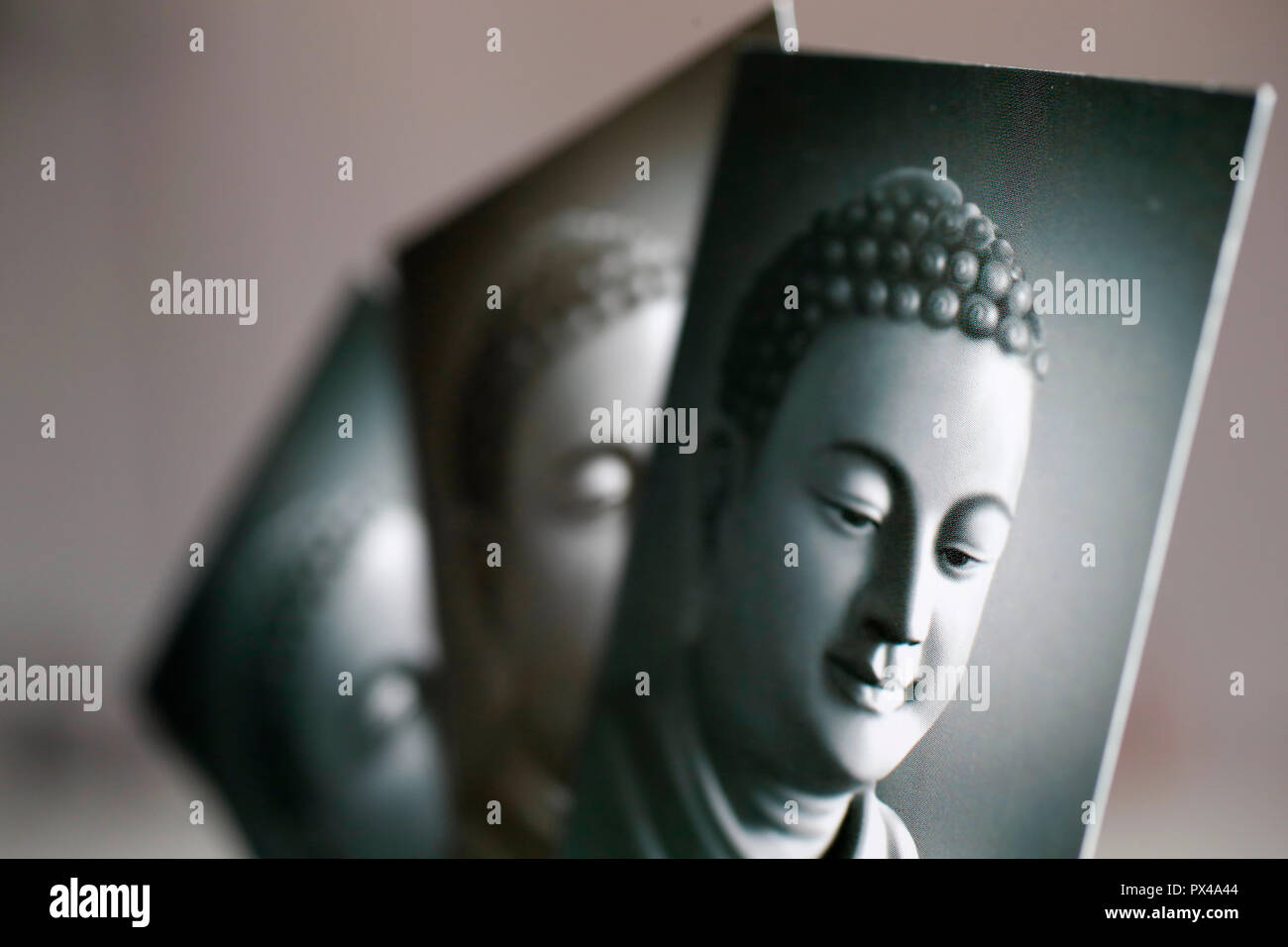 Three black and white images of the Buddha.  Ho Chi Minh City. Vietnam. - Stock Image