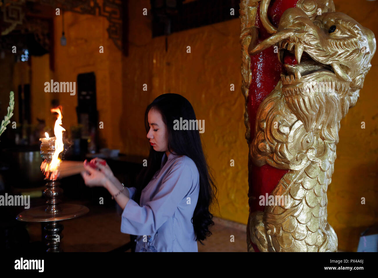 Thien Hung buddhist temple  Praying woman with incense