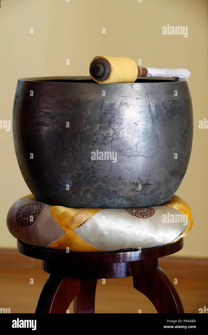 Linh Phong buddhist temple.  Zen Buddhist Bell Bowl  on ceremonial cushion. Dalat. Vietnam. - Stock Image