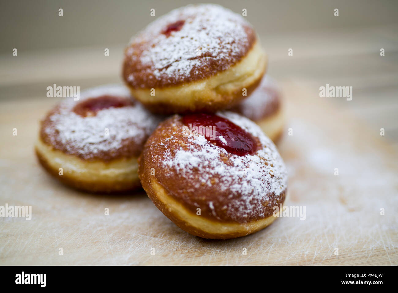 Traditional food for hanukkah is jelly doughnuts with sugar powder. - Stock Image