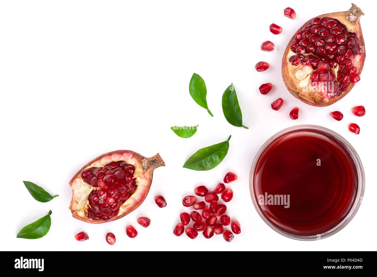 A glass of pomegranate juice with fresh pomegranate fruits isolated on white background with copy space for your text. Top view. Flat lay. Stock Photo