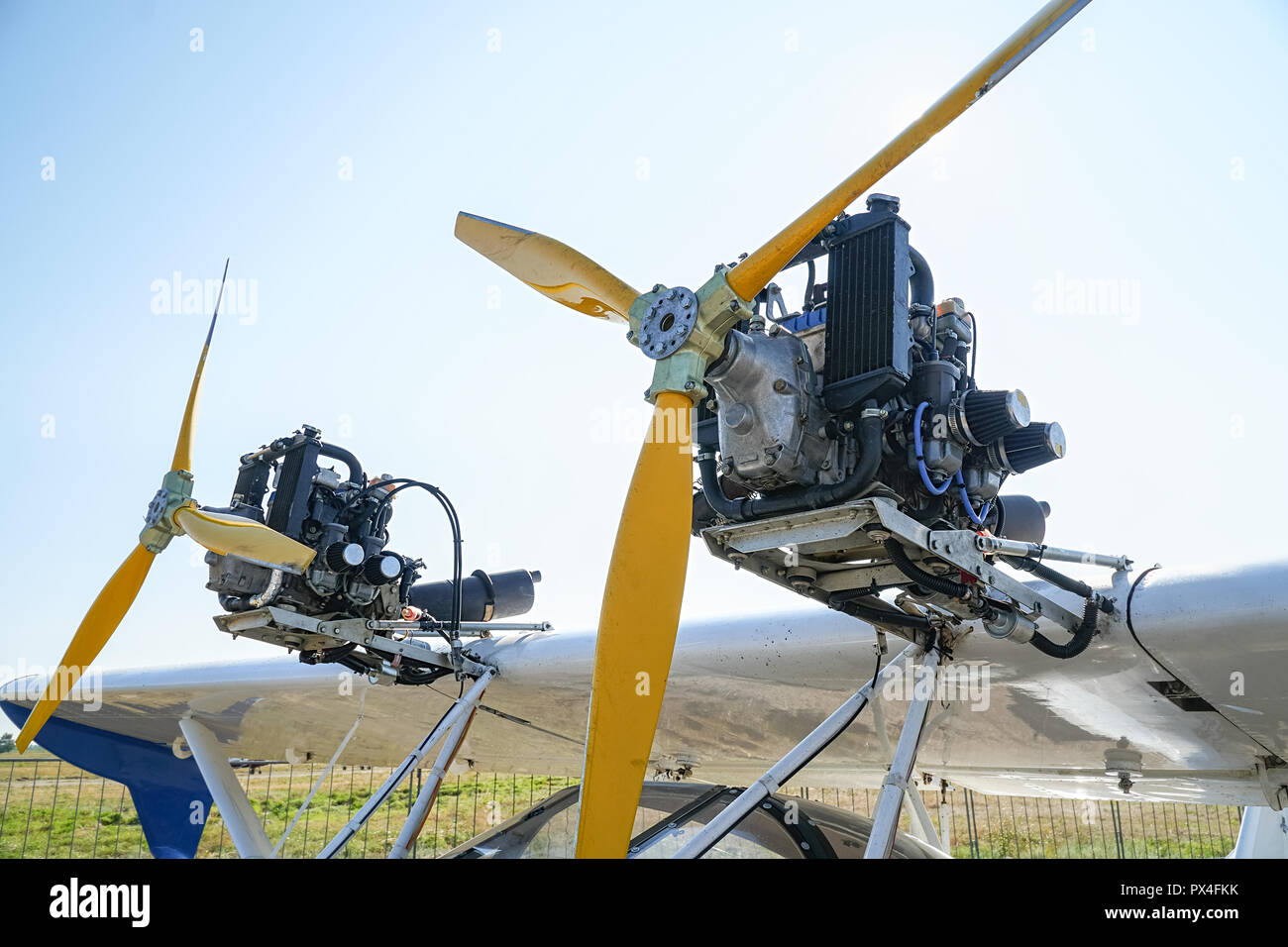 Light aircraft engines against a sky - Stock Image