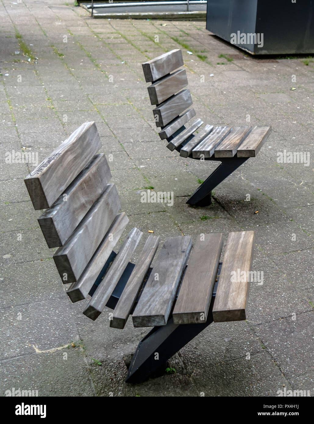 Practical and comfortable street furniture in Rotterdam, Netherlands. All these chairs can rotate on their axis and could be turned to any direction. - Stock Image