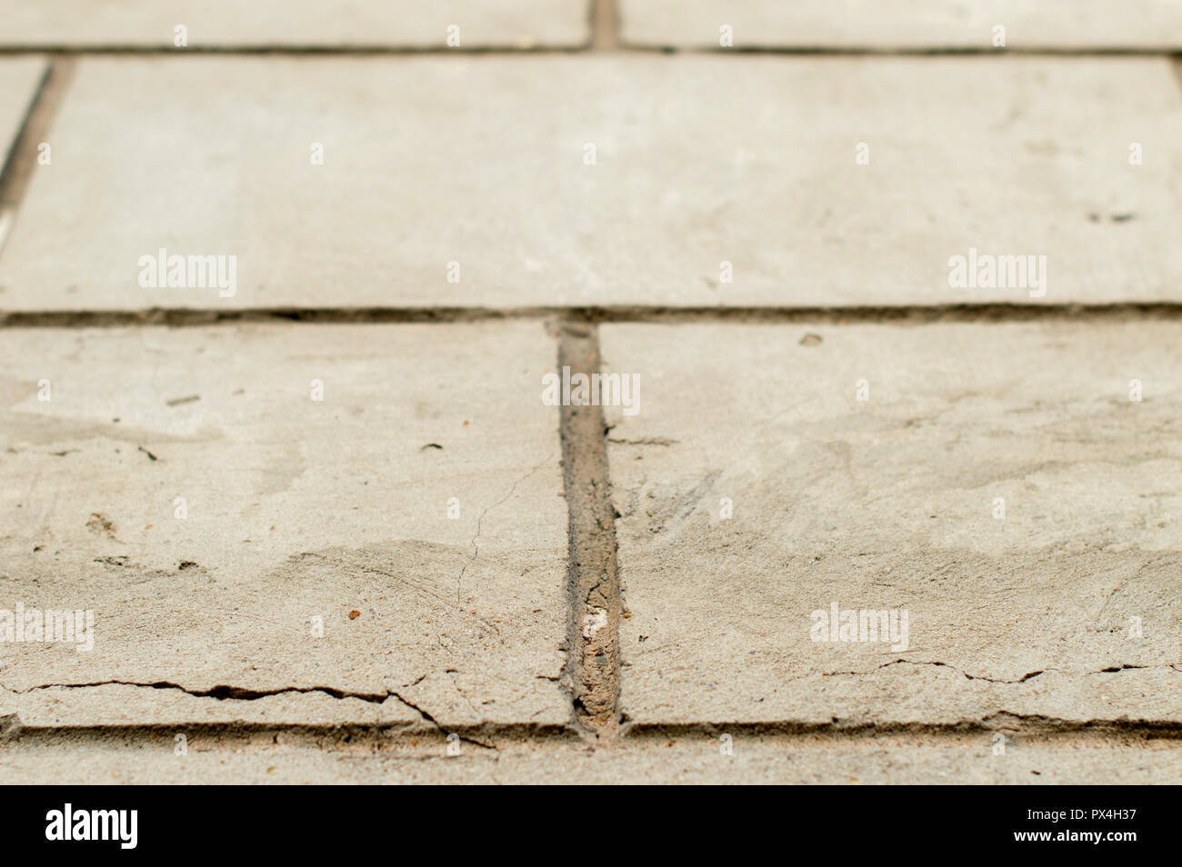 Brick wall, plastered with cement mortar., With the jointing under the pattern of rectangles. Close-up. - Stock Image