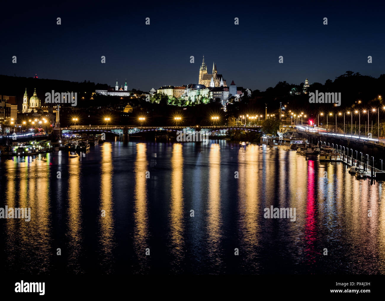 Night in Moldava river, lights of Prague´s cathedral Stock Photo