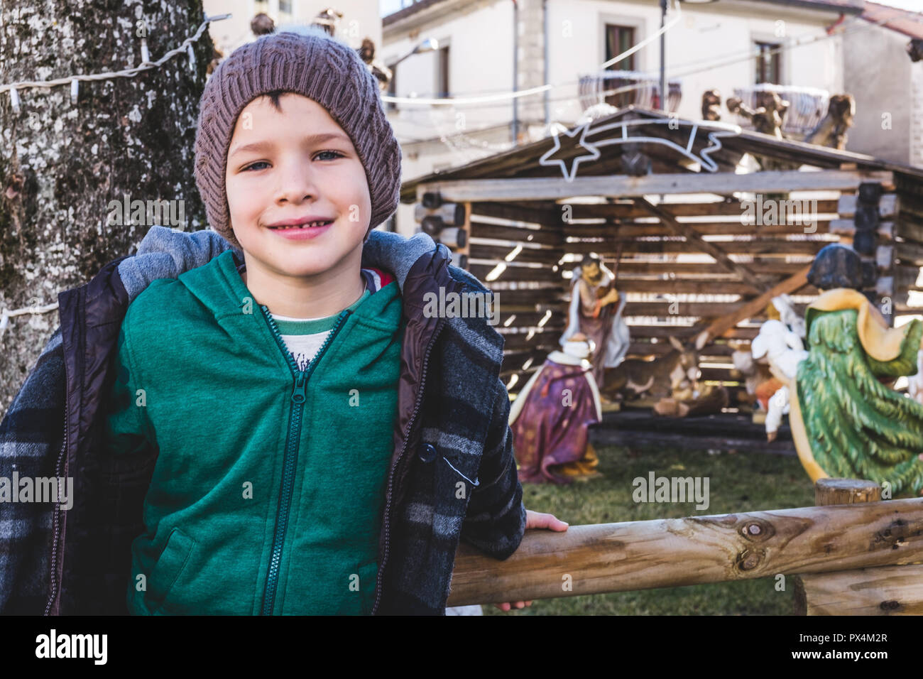 boy with Christmas nativity scene Stock Photo