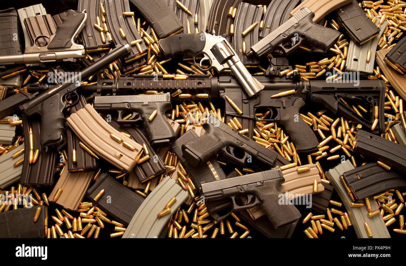 Assault rifle and handguns with ammunition and high capacity magazines. - Stock Image