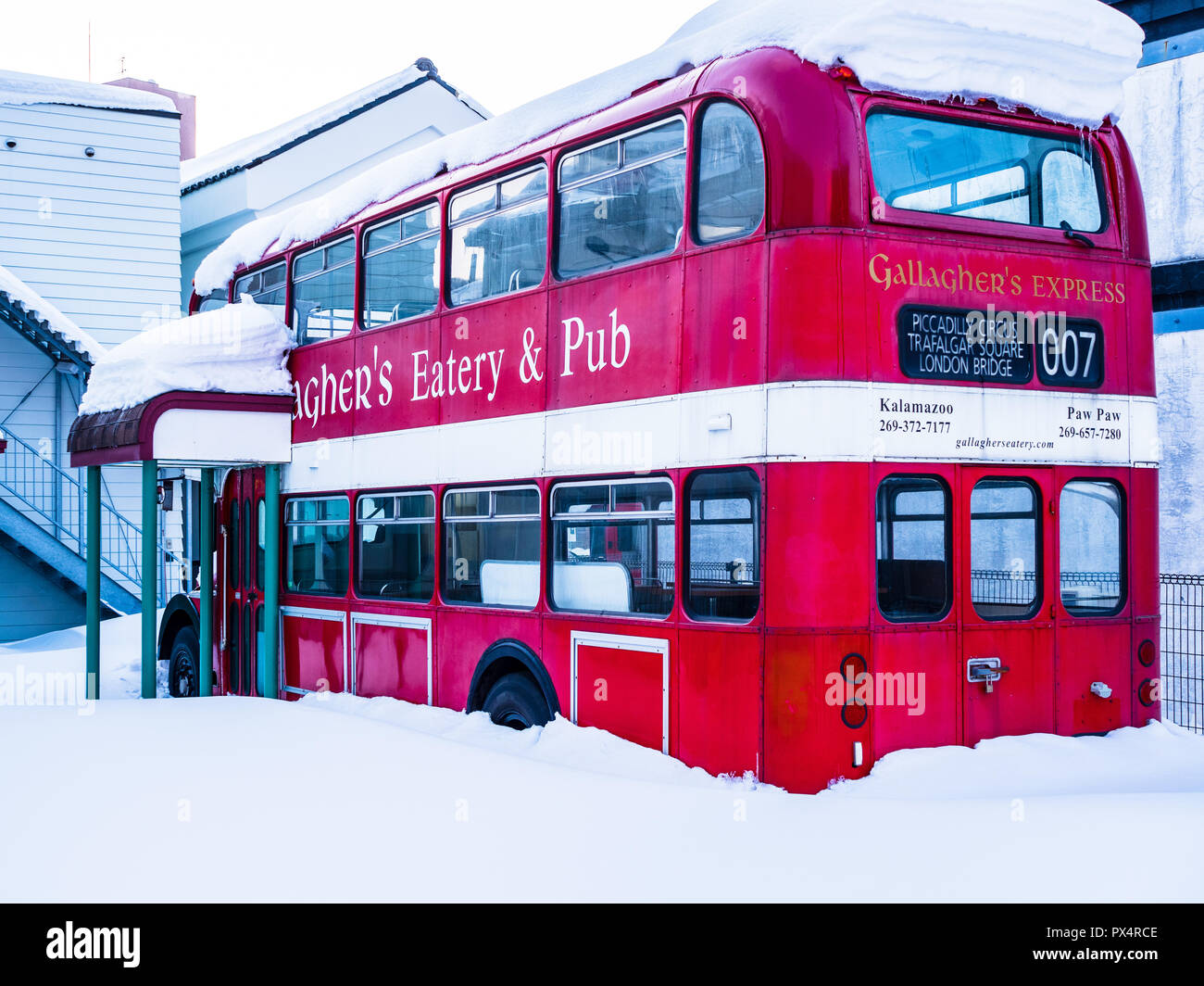 British Bus Japan - a British double decker red bus parked in the yard of a restaurant in the Japanese port city of Hakodate on the island of Hokkaido - Stock Image