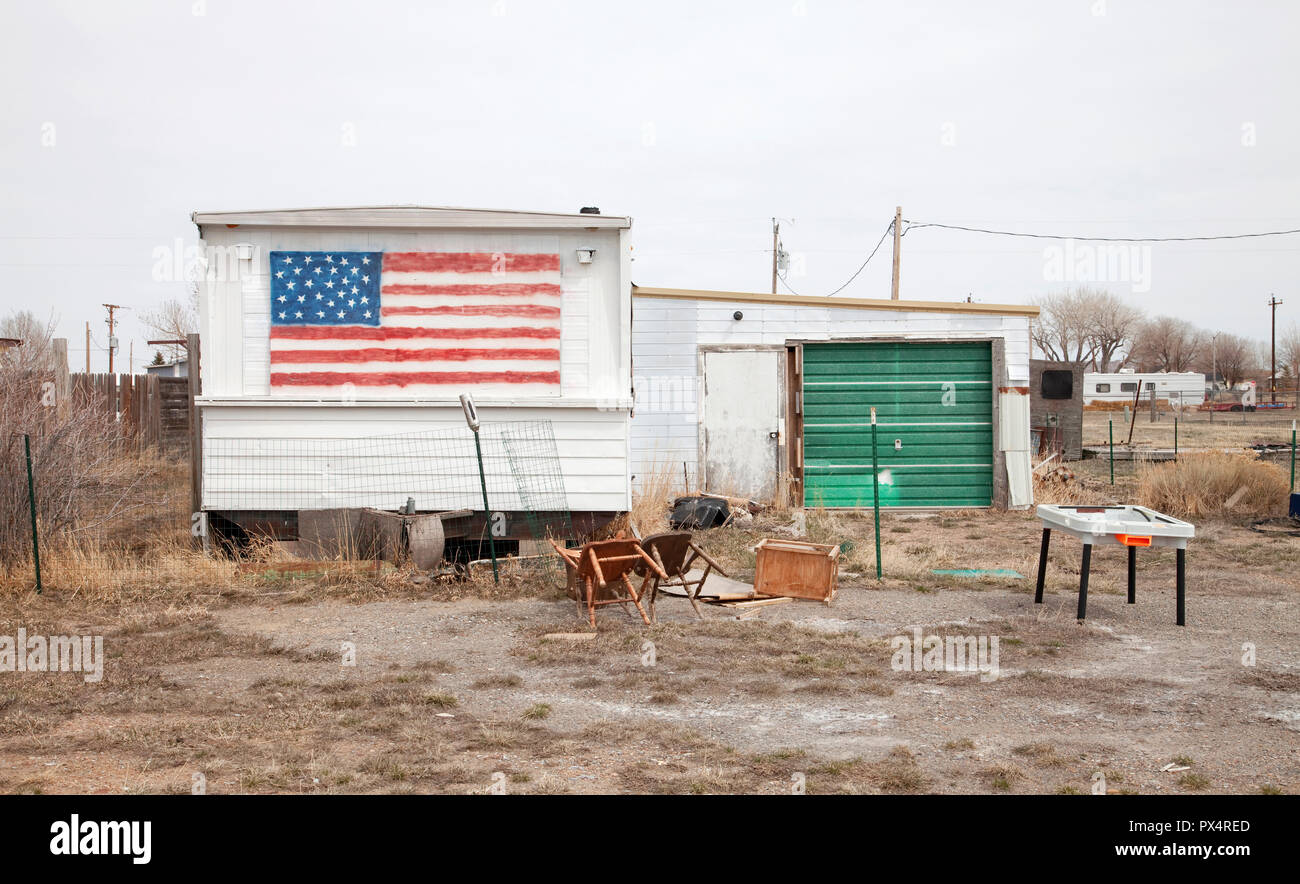 American flag painted on abandoned trailer home.  Wyoming, USA - Stock Image
