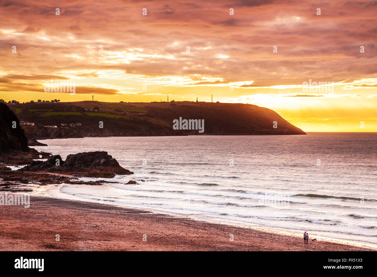 Sunset over the beach at Tresaith in Ceredigion, Wales. - Stock Image