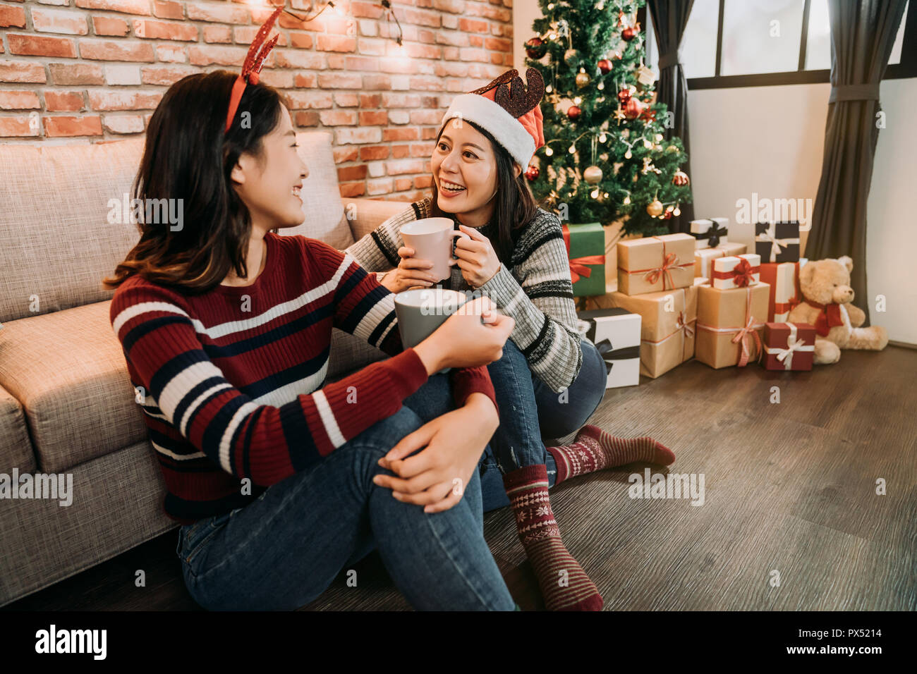 beautiful girlfriends christmas celebration enjoy mulled wine at home saying merry christmas and happy new