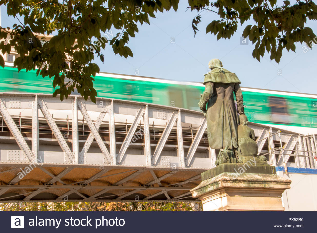 Paris (France), 18 October 2018. Metro line 5 flying over a Parisian square. - Stock Image